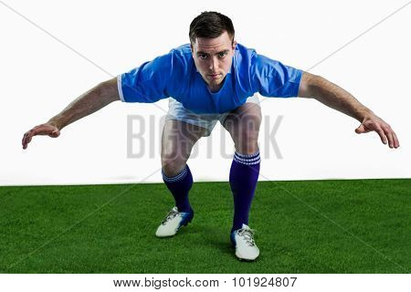 Portrait of a rugby player ready to tackle the opponent