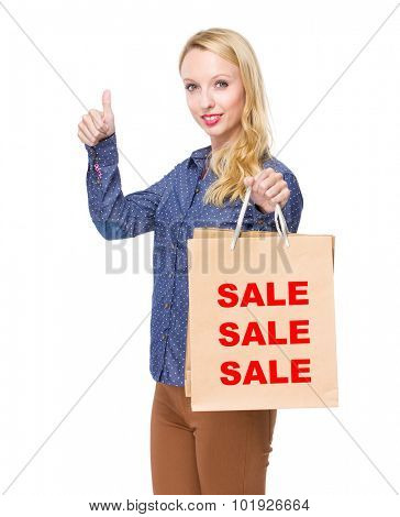 Woman with shopping bag and thumb up for showing three words of sale