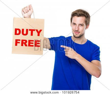 Man finger point to the shopping bag and showing duty free
