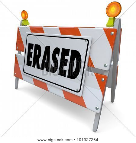 Erased sign on barrier or barricade to warn that something has been corrected, fixed, removed, deleted, cancelled or improved