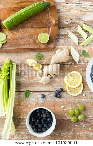 healthy eating, vegetarian food, culinary and diet concept - close up of superfood ingredients on wooden table