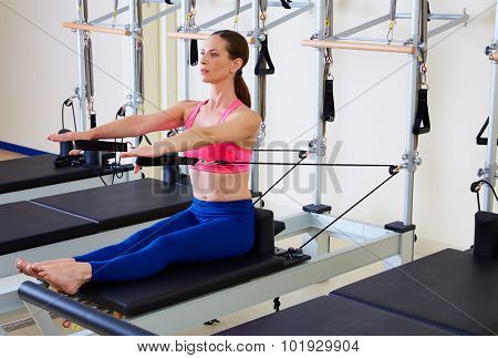 Pilates reformer woman stomach massage flat exercise workout at gym