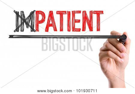 Hand with marker writing the word Impatient/Patient