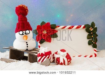 Snowman On A Sledge