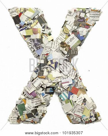 The letter  X  made from newspaper confetti