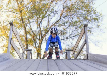 Child roller skating with slides