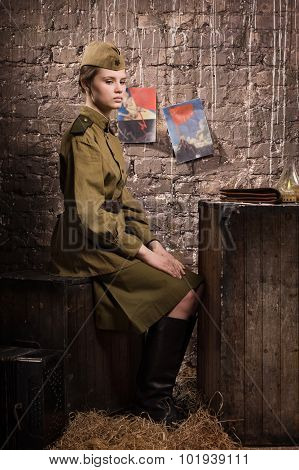 Soviet Female Soldier In Uniform Of World War Ii In The Dugout