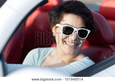 Woman Driving a Convertible