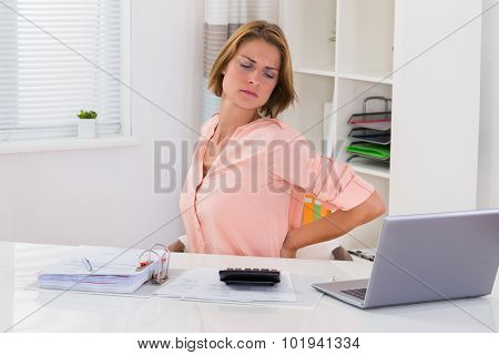 Young Woman Suffering From Backache