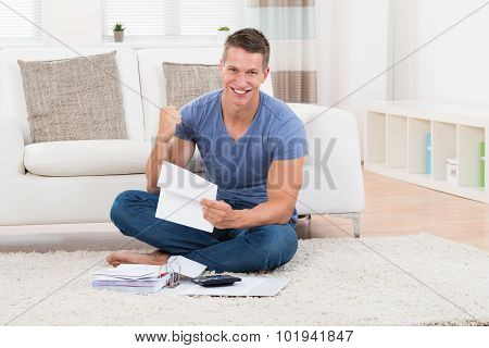 Man With Receipts And Calculator