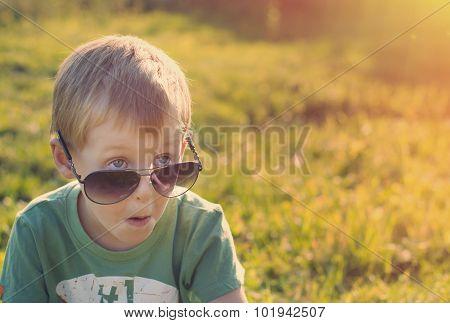 Surprised Child In Sunglasses