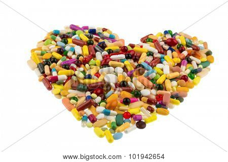 colorful tablets arranged in a heart shape, symbol photo of heart disease, medication and pharmaceuticals
