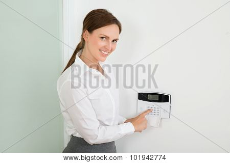 Businesswoman Enter Code In Security System