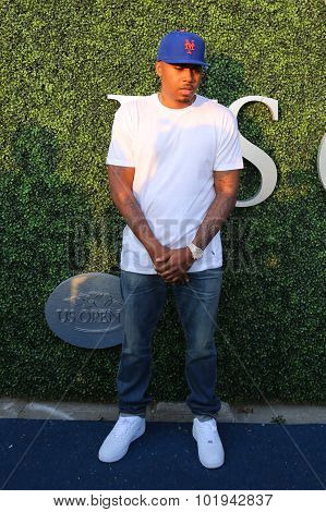 American rapper Nas (R) attends US Open 2015 tennis match between Serena and Venus Williams