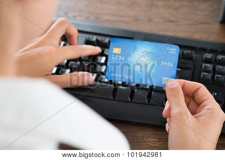 Businessperson Using Computer Keyboard And Credit Card