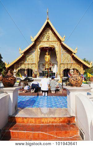 Worshiping Buddha, Thailand
