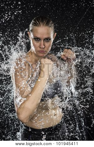 Female Fighter in Water Splashes Looking Fierce