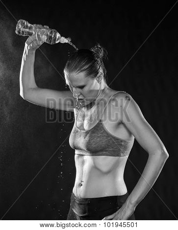 Fit Woman Pouring Water Over Head After Workout