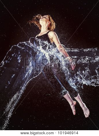 Young Woman in Water Splash Floating in the Air
