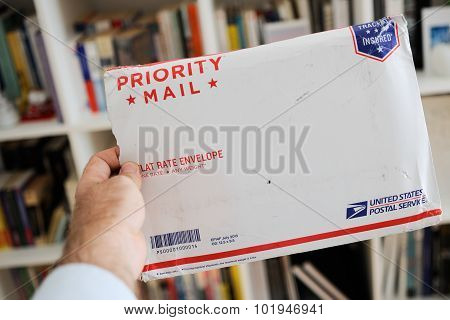 Usps United States Postal Service Parcel Envelope In Man's Hands