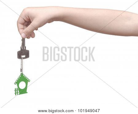 House key in kids hand over white background