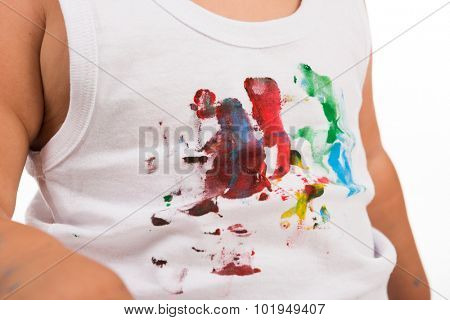 white shirt of a kid painted with colors