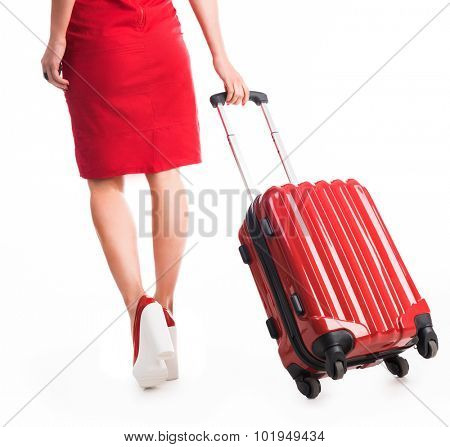 legs of girl going away with suitcase