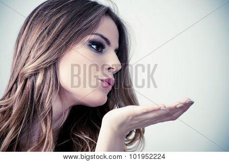 Beautiful teenage girl sending kisses