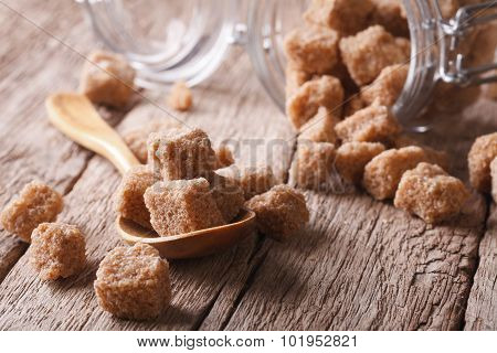 Brown Cane Sugar On A Wooden Table Macro. Horizontal