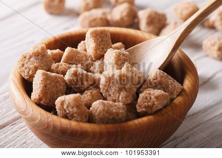 Lump Brown Cane Sugar Macro In A Wooden Bowl. Horizontal
