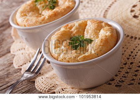 Two Baked Cheese Souffle In A White Pot Close-up. Horizontal