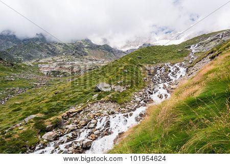 Glacier stream flowing down a valley.