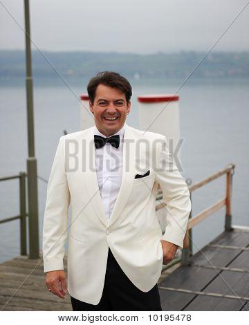 Smiling Groom On Pier