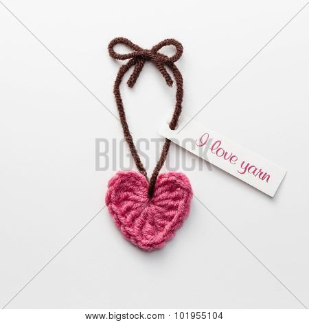 Cute crochet heart with Love Yarn tag