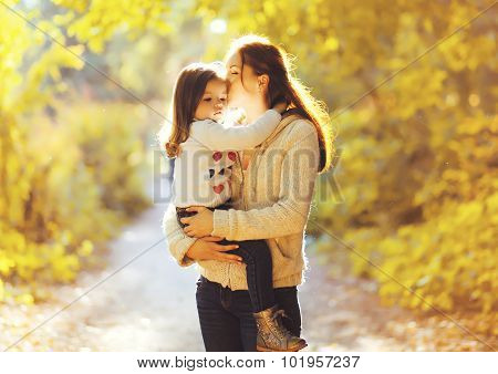 Happiness Mother! Mom Kissing Child In Sunny Autumn Park