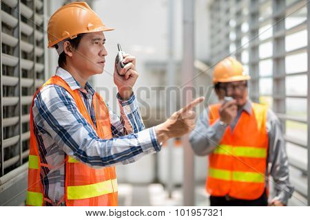 Talking on walkie-talkie
