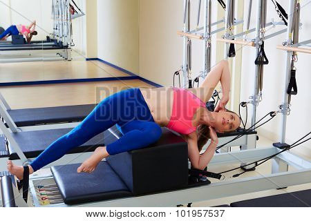 Pilates reformer woman short box side stretch exercise wrkout