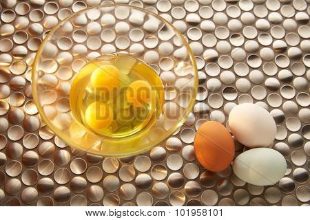 Eggs with blue easter white and brown egg colors on modern stainless steel