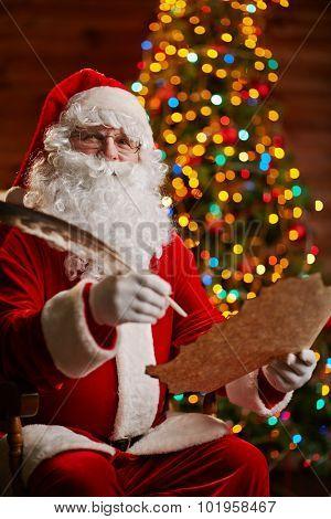 Happy Santa answering Christmas letter