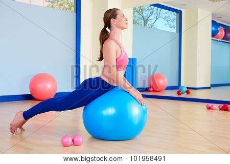 Pilates woman fitball swan exercise workout at gym indoor