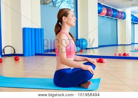Pilates woman stretching exercise workout at gym indoor