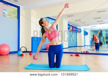 Pilates woman sand balls exercise workout at gym indoor