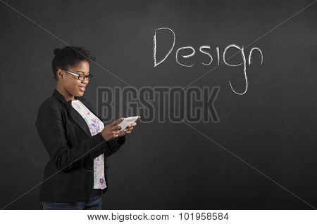 African Woman With Tablet Designing Something On Blackboard Background