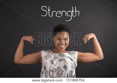 African American Woman With Strong Arms And Strength On Blackboard Background