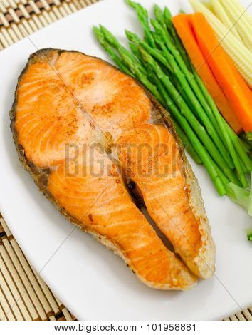 close up shot of salmon steak with vegetable