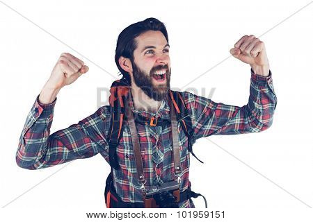 Excited hiker with arms raised against white background