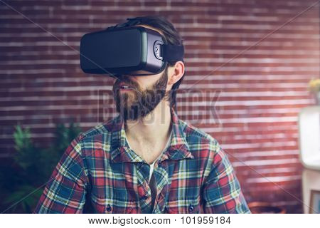 Creative businessman wearing 3D video glasses while looking away at office