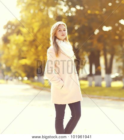 Beautiful Young Woman Wearing A Pink Coat In Sunny Autumn Park