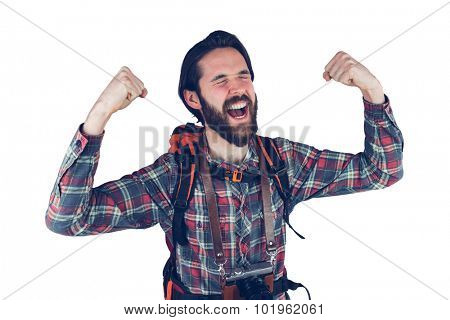 Excited adventurer with arms raised against white background