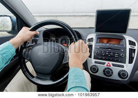 transport, business trip, technology, navigation and people concept -close up of young man with tablet pc computer driving on car parking